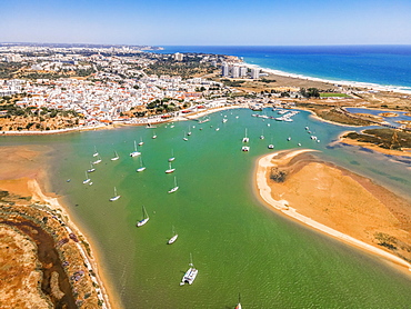 Aerial view, bay with yachts and view of coastal town Alvor, Algarve, Portugal, Europe