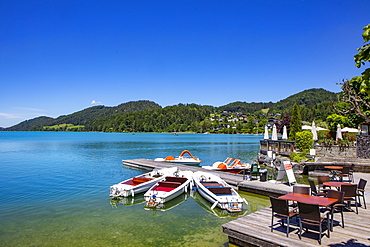 Pedal boats and electric boats at the landing stage on the lake promenade, Fuschlsee, Fuschl am See, Salzkammergut, Province of Salzburg, Austria, Europe