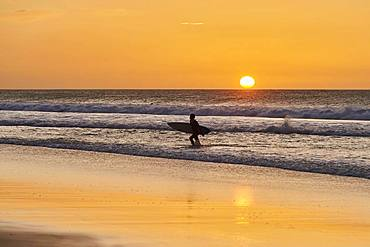 Backlit surfers, sunset beach of Playa del Castillo, Playa del Aljibe de la Cueva, Fuerteventura, Canary Islands, Spain, Europe