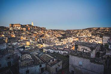 An evening view of the buildings of the old town called Sassi, panoramic view, Matera, Italy, Europe