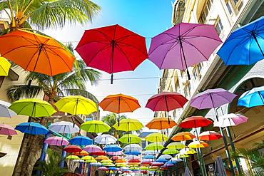 Colorful hanging umbrellas in Caudan waterfront, Mauritius, Africa