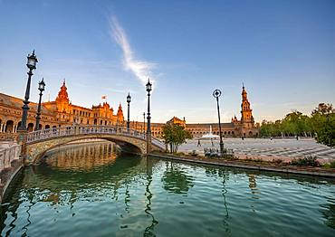 Plaza de Espana in the evening light with reflection, bridge over the canal, Sevilla, Andalusia, Spain, Europe