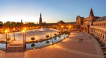 View over the illuminated Plaza de Espana at evening light, Sevilla, Andalusia, Spain, Europe