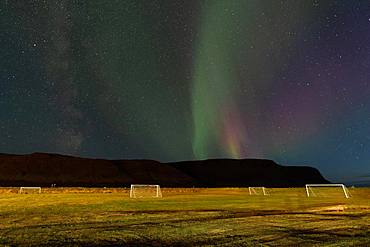 Northern Lights above the football field of the village of Talknafjoerour, Talknafjoerour, Westfjords, Northwest Iceland, Iceland, Europe