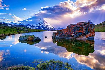 Matterhorn reflected in the Stellisee at sunset, Zermatt, Valais, Switzerland, Europe