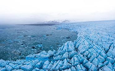 Panoramic view of glacier lagoon and glacier wall, Vatnajoekull Glacier, Iceland, Europe