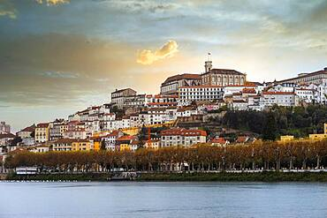 Coimbra cityscape with Mondego river by sunset, Portugal, Europe