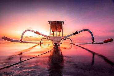 Jukung, Balinese fishing boat at sunrise on the beach, Indonesia, Asia