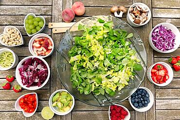 Salad table served in cup with nice wooden background