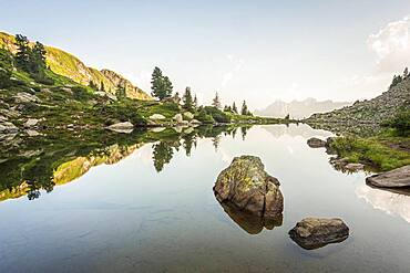 Mirror lake at first light with the Hoher Dachstein in the background, Reiteralm, Styria, Austria, Europe