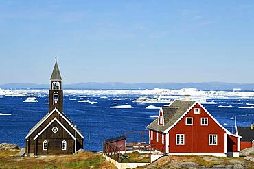 Zion Church and colourful wooden houses, Disko Bay, Ilulissat, West Greenland, Greenland, North America