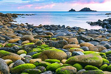 Rocky coast with round stones at Cape Cornwall, St Just, Penwith, Cornwall, England, Great Britain