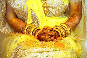 Hand of a bride painted with henna and fresh turmeric paste on the eve of the wedding, Beau Bassin, Mauritius, Africa
