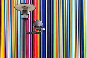 Colourful striped sculpture and street lamp, la Defense, Paris, France, Europe