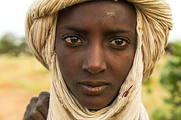 Young Peul man, Gerewol festival, courtship ritual competition among the Fulani ethnic group, Niger, Africa