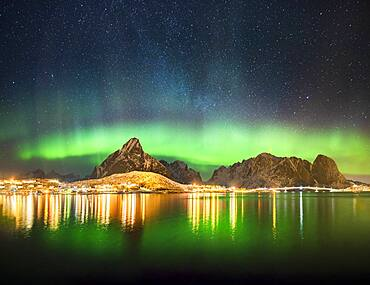 Northern lights at the fjord above the fishing village Reine, Moskenes, Nordland, Lofoten, Norway, Europe
