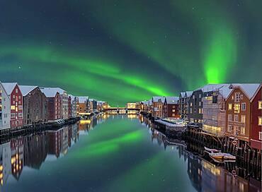 Northern Lights Bakklandet historical warehouses Trondheim Norway