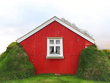 Traditional peat house Lindarbakki with red gable wall, Bakkageroi, Bakkagerdi, Borgarfjoerour, Borgarfjoerdur, Austurland, Iceland, Europe