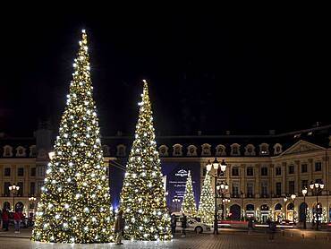 Night shot of illuminated Christmas trees at Place Vendome, Paris, France, Europe