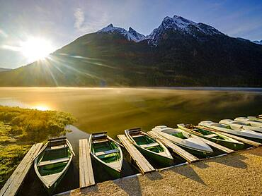 Rowing boats at Hintersee with morning fog at sunrise, in the back Hochkalter, Berchtesgaden National Park, Ramsau, Upper Bavaria, Bavaria, Germany, Europe