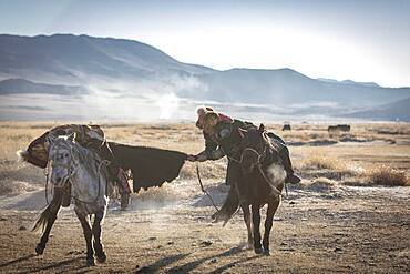 Spai Bashakhan's sons train for the Mongolian equestrian game Buzkaschi, Olgii Province, Mongolia, Asia