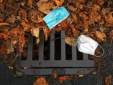 Discarded respirators, street, autumn leaves, Schliersee, Bavaria, Germany, Europe