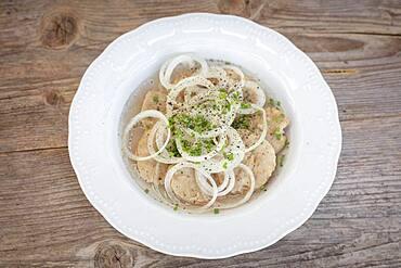 Vinegar dumplings with onion rings, chives, Bavarian snack, Schliersee, Bavaria, Germany, Europe