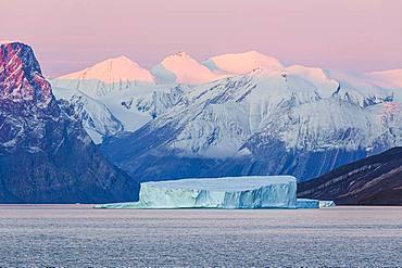 Iceberg in fjord, sunrise, Emperor Franz Joseph Fjord, east coast Greenland, Denmark, Europe