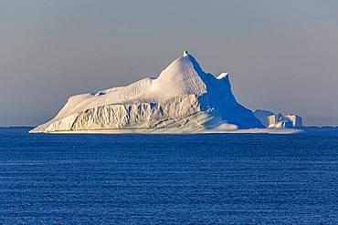 Iceberg in blue sea, east coast Greenland, Denmark, Europe
