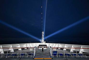 Cruise ship, night, icebergs, searchlights, Atlantic Ocean between Greenland and Iceland