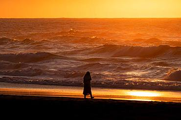 Person walking along the sea, Praia da Adraga, Almocageme, Portugal, Europe