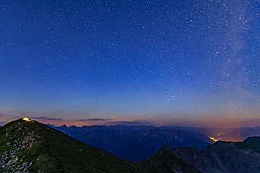 Starry sky summit of Kreuzspitze and tent, Lechtal Alps in the background, Elmen, Lechtal Alps, Ausserfern, Tyrol, Austria, Europe