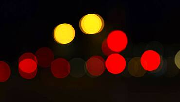 Abstract dark background with sparkling yellow and red lights, Barcelona, Spain, Europe