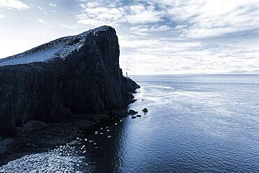 Rocky reef at the North Sea against the light, Neist Point peninsula with lighthouse, Dunvegan, Isle of Sky, Inner Hebrides, Scotland, Great Britain