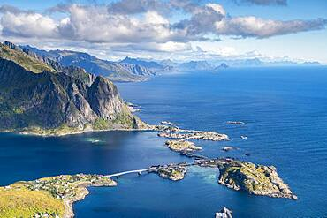 View from Reinebringen mountain to the fishing village Hamnoy, fjord with islands and mountains, Reinefjord, Lofoten, Norway, Europe