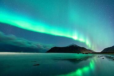 Flakstad beach with northern lights, Flakstad, Lofoten, Norway, Europe