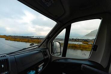 View from a rainy campervan window on Flakstad beach, Flakstad, Lofoten, Norway, Europe