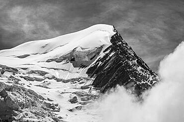 Black and white, high alpine mountain landscape, peak Aiguille du Gouter with glacier, Glacier de Taconnaz, behind Mont Blanc, Chamonix, Haute-Savoie, France, Europe