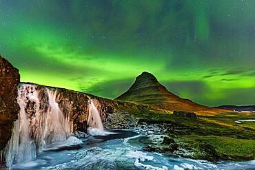 Aurora Borealis, Kirkjufellsfoss with Mount Kirjufell, Snaefellsnes Peninsula, Iceland, Europe