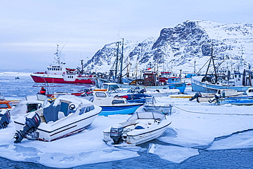 Fishing boats in the ice, harbour, Sisimiut, west coast, Greenland, North America
