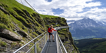 Hiker on a secured hiking trail on the slope, First, Jungfrau Region, Grindelwald, Bern, Switzerland, Europe