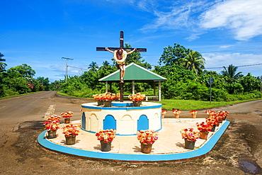 Christian statue at a road bend, Wallis, Wallis and Futuna, Oceania