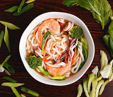 Chinese noodles soup with prawns and vegatable