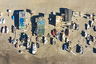 Fishing boats and fishermen cottages at the beach of San Miguel de Cabo de Gata, aerial view, drone shot, Nature Reserve Cabo de Gata-Nijar, Almeria province, Andalusia, Spain, Europe