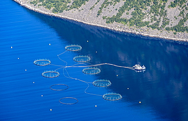 Aquaculture, fish farm in a fjord, Nordland, Norway, Europe