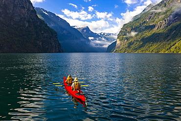 Red kayak in Geirangerfjord, near Geiranger, More og Romsdal, Norway, Europe