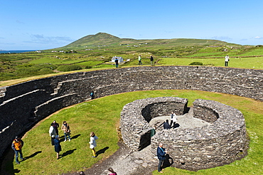 Archaeology, tourists, iron age ring fort Cahergall, Cahersiveen, Ring of Kerry, County Kerry, Ireland, Europe