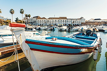 Old town of Faro with traditional wooden boat moored in marina, Algarve, Portugal, Europe