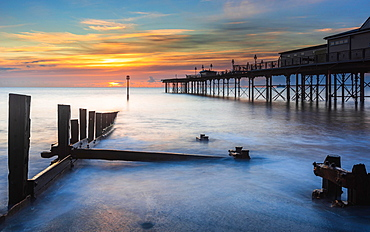 Sunrise in long time exposure of Grand Pier, Teignmouth, Devon, England, Great Britain