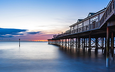 Sunrise in long time exposure of Grand Pier, Teignmouth, Devon, England, United Kingdom, Europe